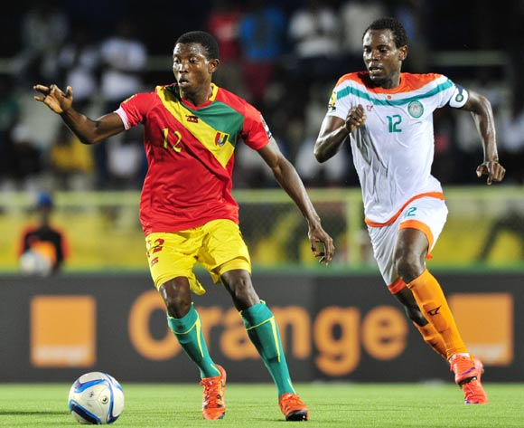 Aboubacar Sylla of Guinea challenged by Souleymane Sakou Dela of Niger during the 2016 CHAN Rwanda, match between Niger and Guinea at the Stade de Kigali in Kigali, Rwanda on 22 January 2016 ©Muzi Ntombela/BackpagePix