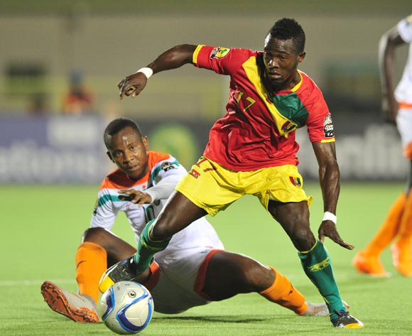 Daouda Camara of Guinea shields ball from Mossi Adamou Moussa Issa of Niger during the 2016 CHAN Rwanda, match between Niger and Guinea at the Stade de Kigali in Kigali, Rwanda on 22 January 2016 ©Muzi Ntombela/BackpagePix