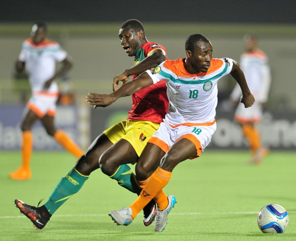 Kofi Dankwa of Niger challenged by Alseny Camara of Guinea during the 2016 CHAN Rwanda, match between Niger and Guinea at the Stade de Kigali in Kigali, Rwanda on 22 January 2016 ©Muzi Ntombela/BackpagePix
