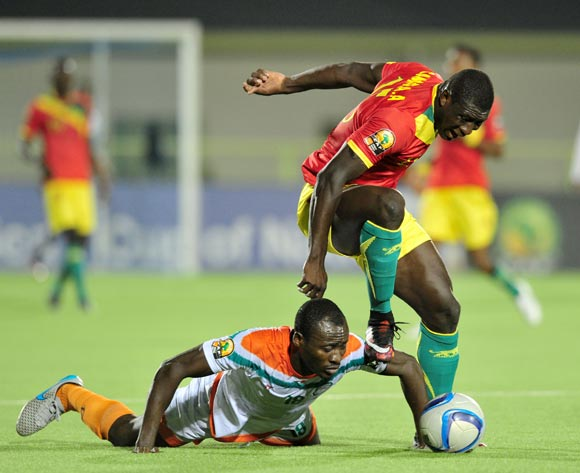 Kofi Dankwa of Niger fouled by Alseny Camara of Guinea  during the 2016 CHAN Rwanda, match between Niger and Guinea at the Stade de Kigali in Kigali, Rwanda on 22 January 2016 ©Muzi Ntombela/BackpagePix