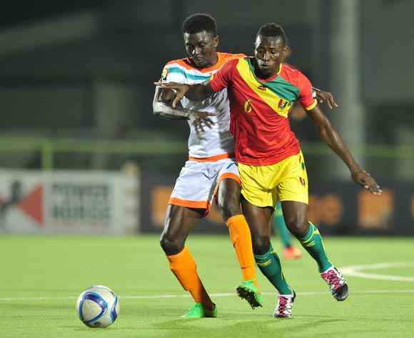 Ibrahima Sory Sankhon  of Guinea challenged by Issa Moussa Mossi Chinois of Niger during the 2016 CHAN Rwanda, match between Niger and Guinea at the Stade de Kigali in Kigali, Rwanda on 22 January 2016 ©Muzi Ntombela/BackpagePix