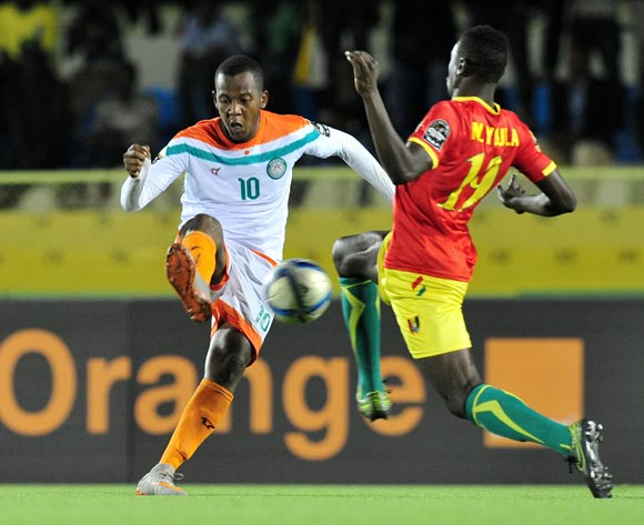 Mossi Adamou Moussa Issa of Niger challenged by Jean Mouste of Guinea  during the 2016 CHAN Rwanda, match between Niger and Guinea at the Stade de Kigali in Kigali, Rwanda on 22 January 2016 ©Muzi Ntombela/BackpagePix
