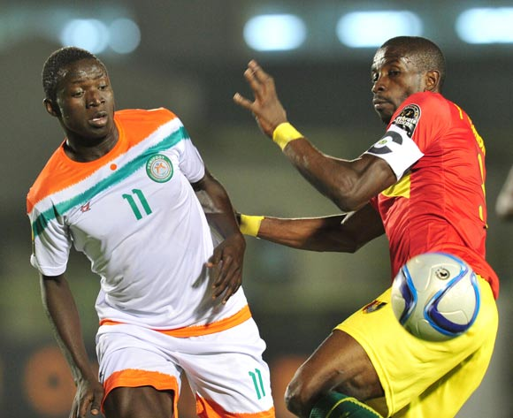 Ibrahima Sory Bangoura of Guinea challenged by Zakari Victorien Adje Adebayor of Niger during the 2016 CHAN Rwanda, match between Niger and Guinea at the Stade de Kigali in Kigali, Rwanda on 22 January 2016 ©Muzi Ntombela/BackpagePix
