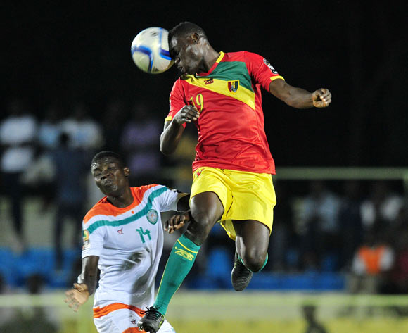 Mohamed Youla of Guinea clears ball away from Imrana Seyni of Niger during the 2016 CHAN Rwanda, match between Niger and Guinea at the Stade de Kigali in Kigali, Rwanda on 22 January 2016 ©Muzi Ntombela/BackpagePix