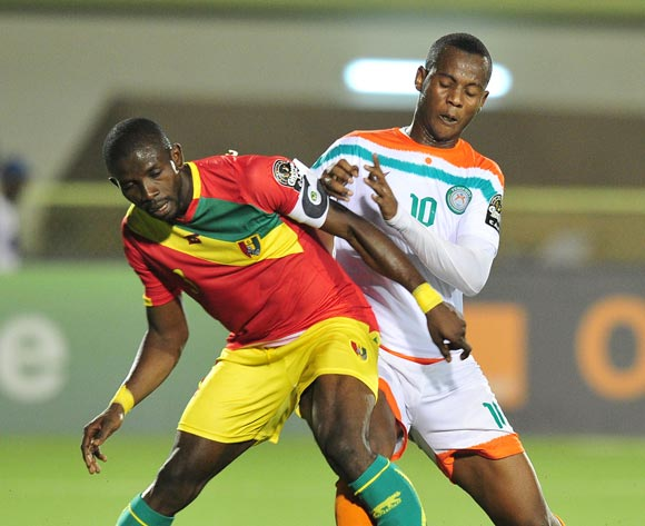 Ibrahima Sory Bangoura of Guinea  challenged by Mossi Adamou Moussa Issa of Niger during the 2016 CHAN Rwanda, match between Niger and Guinea at the Stade de Kigali in Kigali, Rwanda on 22 January 2016 ©Muzi Ntombela/BackpagePix