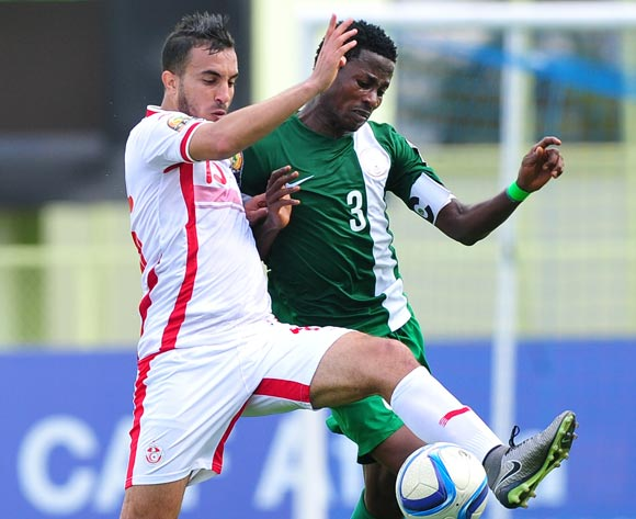 Mohamed Ali Monser of Tunisia is challenged by Chima Akas of Nigeria during the 2016 CHAN Rwanda game between Tunisia and Nigeria at Stade de  Kigali, Kigali on 22 January 2016 ©Ryan Wilkisky/BackpagePix