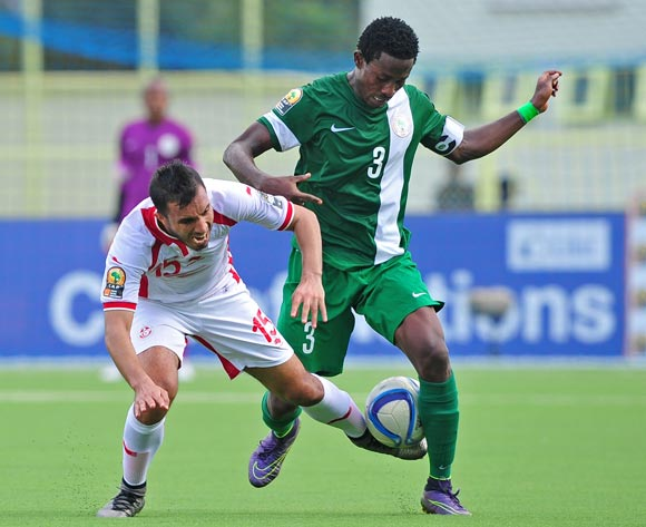 Mohamed Ali Monser of Tunisia is fouled by Chima Akas of Nigeria during the 2016 CHAN Rwanda game between Tunisia and Nigeria at Stade de  Kigali, Kigali on 22 January 2016 ©Ryan Wilkisky/BackpagePix