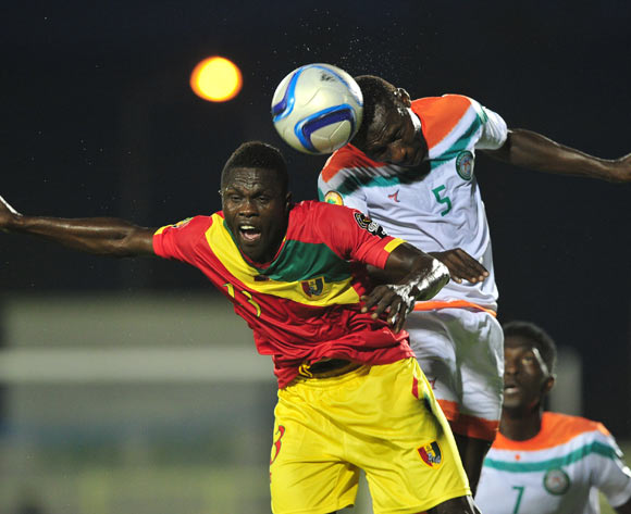 Musa Shehu Maïkudi of Niger beats Alsény Camara of Guinea in the air during the 2016 CHAN Rwanda game between Niger and Guinea at the Stade de Kigali, Kigali on 22 January 2016 ©Ryan Wilkisky/BackpagePix