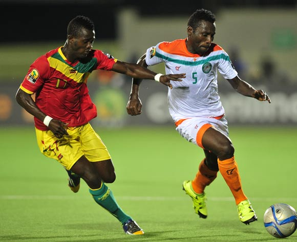 Musa Shehu Maïkudi of Niger takes on Daouda Camara of Guinea during the 2016 CHAN Rwanda game between Niger and Guinea at the Stade de Kigali, Kigali on 22 January 2016 ©Ryan Wilkisky/BackpagePix