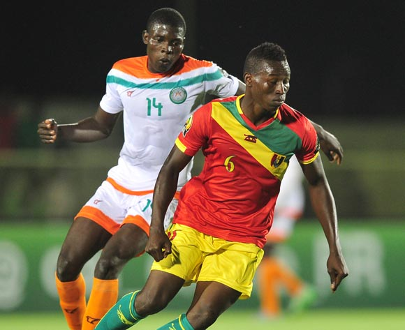 Ibrahima Sory Sankhon  of Guinea turns away from Imrana Seyni of Niger during the 2016 CHAN Rwanda game between Niger and Guinea at the Stade de Kigali, Kigali on 22 January 2016 ©Ryan Wilkisky/BackpagePix
