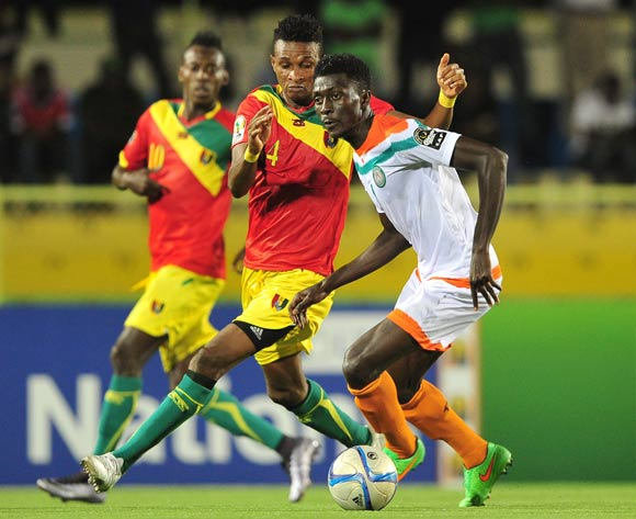Issa Moussa Mossi Chinois of Niger takes on Thierno Camara of Guinea during the 2016 CHAN Rwanda game between Niger and Guinea at the Stade de Kigali, Kigali on 22 January 2016 ©Ryan Wilkisky/BackpagePix