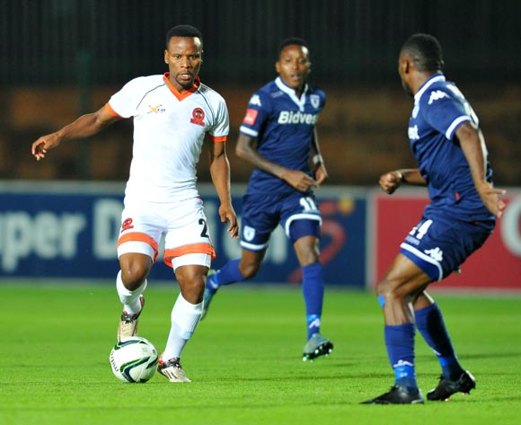 Thobani Mncwango of Polokwane City challenged by Onismor Bhasera of Bidvest Wits during the Absa Premiership match between Bidvest Wits and Polokwane City at the Bidvest Stadium in Johannesburg, South Africa on January 22, 2016 ©Samuel Shivambu/BackpagePix