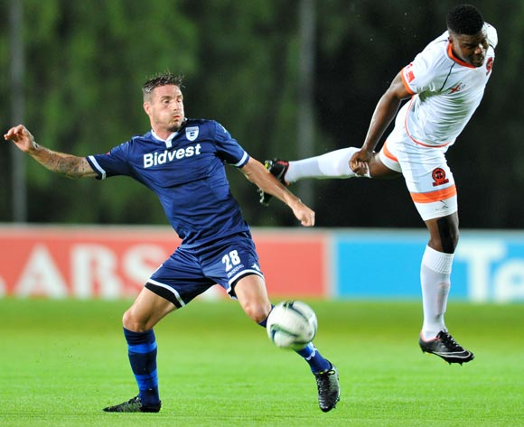James Keene of Bidvest Wits challenged by Tshepo Tema of Polokwane City during the Absa Premiership match between Bidvest Wits and Polokwane City at the Bidvest Stadium in Johannesburg, South Africa on January 22, 2016 ©Samuel Shivambu/BackpagePix
