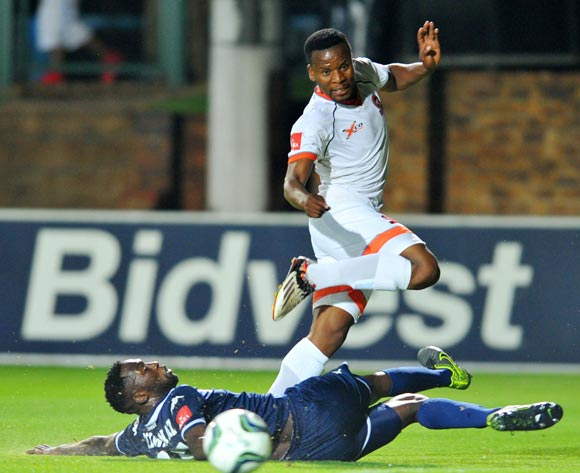 Thobani Mncwango of Polokwane City tackled by Buhle Mkhwanazi of Bidvest Wits during the Absa Premiership match between Bidvest Wits and Polokwane City at the Bidvest Stadium in Johannesburg, South Africa on January 22, 2016 ©Samuel Shivambu/BackpagePix