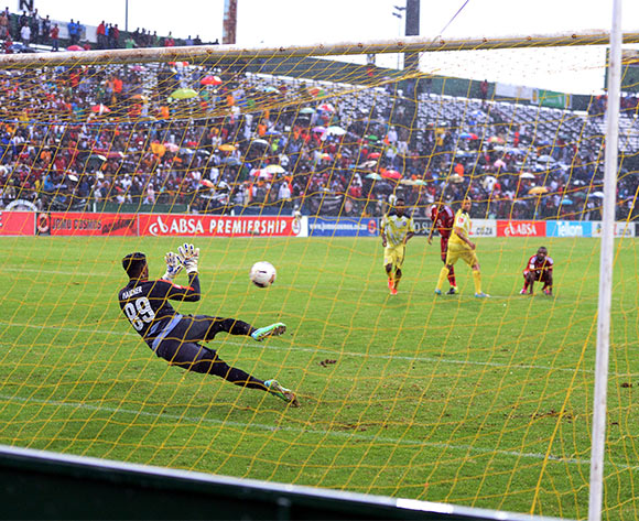 Sherywn Naicker Cosmos goal keeper saves a penalty taken by Lehlohonolo Majoro during the League game against Orlando Pirates at Olen Park Stadium. photo by TMK photos