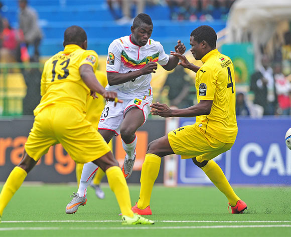 Sekou Koita of Mali shoots at goal as Stephen Makatuka and Lawrence Mhlanga of Zimbabwe close him down during the 2016 CHAN Rwanda game between Zimbabwe and Mali at the Rubavu Stadium, Rubavu on 23 January 2016 ©Ryan Wilkisky/BackpagePix