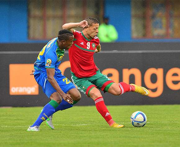 Abdesslam Benjelloun of Morocco tackled by Abdul Rwatubyaye of Rwanda  during the 2016 CHAN football match between Morocco and Rwanda at the Amahoro Stadium in Kigali, Rwanda on 24 January 2016 ©Gavin Barker/BackpagePix