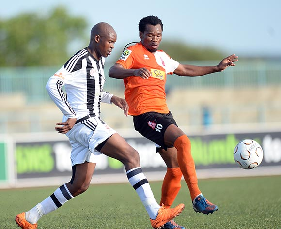 Keabetswe Jenamiso of Mochudi centre Chiefs and Kenanao Kgetholetsile of Gilbert Lions during the beMobile Botswana premier league match between Mochudi centre Chiefs and Gilbert Lions at the Molepolole Sports complex in Botswana on 24 January 2016. MONIRUL BHUIYAN/Backpage pix