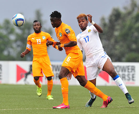 Soualio Dabila Ouattara of Ivory Coast challenged by Aaron Salem Boupendza of Gabon