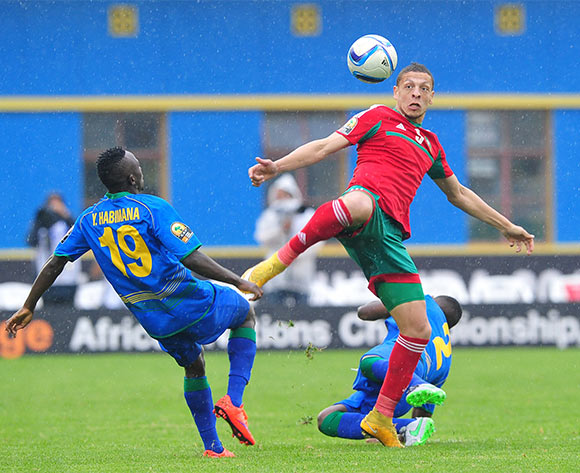 Abdesslam Benjelloun of Morocco gets to the ball ahead of Yussufu Habimana of Rwanda during the 2016 CHAN Rwanda game between Morocco and Rwanda at the Amahoro Stadium, Kigali on 24 January 2016 ©Ryan Wilkisky/BackpagePix