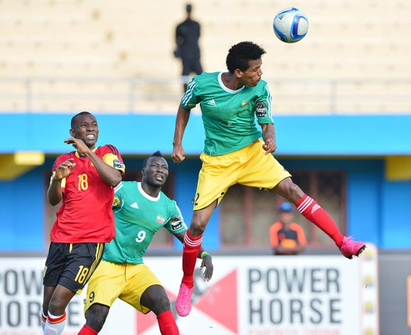 Tekalign Dejene of Ethiopia heads ball clear from teammate Deng Ramkel Lok and Mingo Bille Zalata of Angola during the 2016 CHAN football match between Ethiopia and Angola  at the Amahoro Stadium in Kigali, Rwanda on 25 January 2016 ©Gavin Barker/BackpagePix