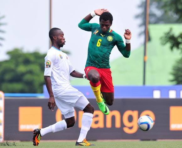 Anthony Kevin Mfede Junior of Cameroon challenged by Sedrick Ngulubi of DR Congo during the 2016 CHAN Rwanda, match between Cameroon and DR Congo at the Huye Stadium in Butare, Rwanda on 25 January 2016 ©Muzi Ntombela/BackpagePix