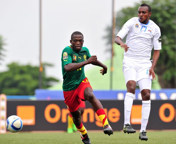 Stephan Mpondo Kingue of Cameroon challenged by Merveille Bope of DR Congo  during the 2016 CHAN Rwanda, match between Cameroon and DR Congo at the Huye Stadium in Butare, Rwanda on 25 January 2016 ©Muzi Ntombela/BackpagePix