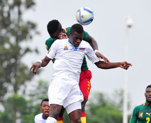 Jean Marc Makusu of DR Congo battles with Paul Serge Atangana of Cameroon during the 2016 CHAN Rwanda, match between Cameroon and DR Congo at the Huye Stadium in Butare, Rwanda on 25 January 2016 ©Muzi Ntombela/BackpagePix