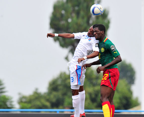 Ricky Tulenge of DR Congo battles with Samuel Gouet Oum of Cameroon during the 2016 CHAN Rwanda, match between Cameroon and DR Congo at the Huye Stadium in Butare, Rwanda on 25 January 2016 ©Muzi Ntombela/BackpagePix