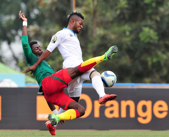 Christian Ngudikama of DR Congo tackled by Anthony Kevin Mfede Junior of Cameroon during the 2016 CHAN Rwanda, match between Cameroon and DR Congo at the Huye Stadium in Butare, Rwanda on 25 January 2016 ©Muzi Ntombela/BackpagePix