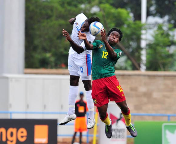 Samuel Nlend of Cameroon battles with Frank Mfuki of DR Congo during the 2016 CHAN Rwanda, match between Cameroon and DR Congo at the Huye Stadium in Butare, Rwanda on 25 January 2016 ©Muzi Ntombela/BackpagePix