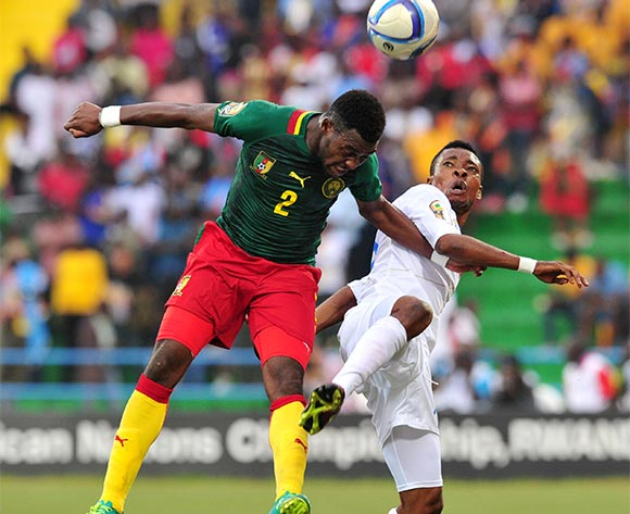 Ricky Tulenge of DR Congo battles with Joseph Ngwem of Cameroon during the 2016 CHAN Rwanda, match between Cameroon and DR Congo at the Huye Stadium in Butare, Rwanda on 25 January 2016 ©Muzi Ntombela/BackpagePix