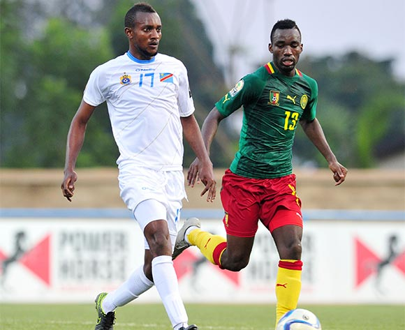 Merveille Bope of DR Congo challenged by Nicloas Brice Mouumi of Cameroon  during the 2016 CHAN Rwanda, match between Cameroon and DR Congo at the Huye Stadium in Butare, Rwanda on 25 January 2016 ©Muzi Ntombela/BackpagePix