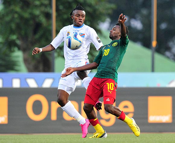 Emane Yazid Atouba of Cameroon challenged by Christian Ngimbi of DR Congo  during the 2016 CHAN Rwanda, match between Cameroon and DR Congo at the Huye Stadium in Butare, Rwanda on 25 January 2016 ©Muzi Ntombela/BackpagePix