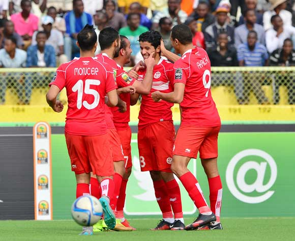 Saad Bguir of Tunisia (second from right)| embraced by teammates after scoring during the 2016 CHAN football match between Niger and Tunisia at the Stade de Kigali in Kigali, Rwanda on 26 January 2016 ©Gavin Barker/BackpagePix