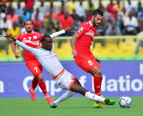 Youssouf Alio Oumarou Balley of Niger fouls Abdelkader Oueslati of Tunisia during the 2016 CHAN football match between Niger and Tunisia at the Stade de Kigali in Kigali, Rwanda on 26 January 2016 ©Gavin Barker/BackpagePix