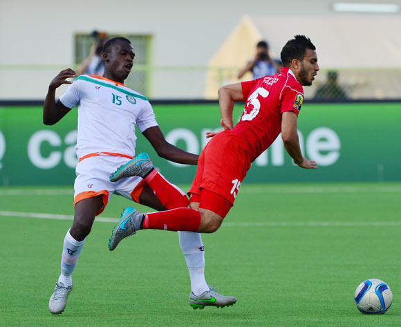 Katkoré Boureima of Niger fouls Mohamed Ali Monser of Tunisia during the 2016 CHAN football match between Niger and Tunisia at the Stade de Kigali in Kigali, Rwanda on 26 January 2016 ©Gavin Barker/BackpagePix