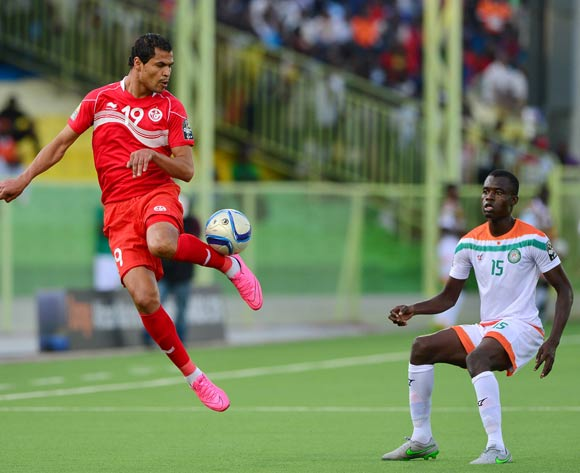 Hichem Essifi of Tunisia controls ball away from Katkoré Boureima of Niger during the 2016 CHAN football match between Niger and Tunisia at the Stade de Kigali in Kigali, Rwanda on 26 January 2016 ©Gavin Barker/BackpagePix