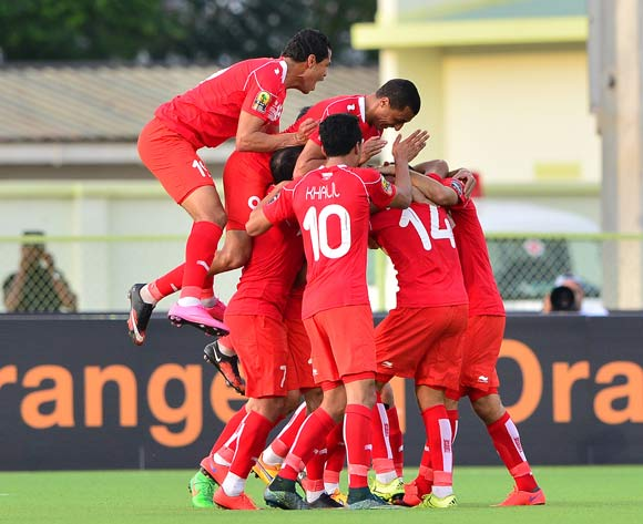 Tunisia players celebrate with goalscorer Mohamed Ben Amor of Tunisia (number 14) during the 2016 CHAN football match between Niger and Tunisia at the Stade de Kigali in Kigali, Rwanda on 26 January 2016 ©Gavin Barker/BackpagePix
