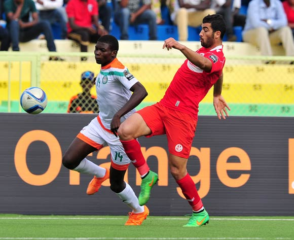 Imrana Seyni of Niger challenged by Yassine Meriah of Tunisia during the 2016 CHAN Rwanda, match between Niger and Tunisia at the Stade de Kigali in Kigali, Rwanda on 26 January 2016 ©Muzi Ntombela/BackpagePix