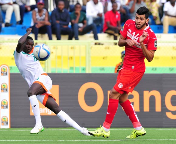 Zakari Victorien Adje Adebayor of Niger takes a shot art goal while challenged by Mohamed Ben Amor of Tunisia during the 2016 CHAN Rwanda, match between Niger and Tunisia at the Stade de Kigali in Kigali, Rwanda on 26 January 2016 ©Muzi Ntombela/BackpagePix
