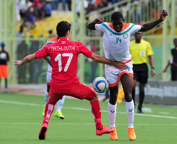 Imrana Seyni of Niger challenged by Hamza Mathlouthi of Tunisia during the 2016 CHAN Rwanda, match between Niger and Tunisia at the Stade de Kigali in Kigali, Rwanda on 26 January 2016 ©Muzi Ntombela/BackpagePix