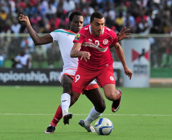 Ahmed Akaichi of Tunisia battles with Souleymane Sakou Dela of Niger during the 2016 CHAN Rwanda, match between Niger and Tunisia at the Stade de Kigali in Kigali, Rwanda on 26 January 2016 ©Muzi Ntombela/BackpagePix