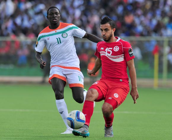 Mohamed Ali Monser of Tunisia challenged by Zakari Victorien Adjé Adebayor of Niger during the 2016 CHAN Rwanda, match between Niger and Tunisia at the Stade de Kigali in Kigali, Rwanda on 26 January 2016 ©Muzi Ntombela/BackpagePix