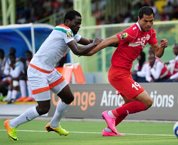 Hichem Essifi of Tunisia challenged by Ganiyu Elh Hutmanu of Niger during the 2016 CHAN Rwanda, match between Niger and Tunisia at the Stade de Kigali in Kigali, Rwanda on 26 January 2016 ©Muzi Ntombela/BackpagePix