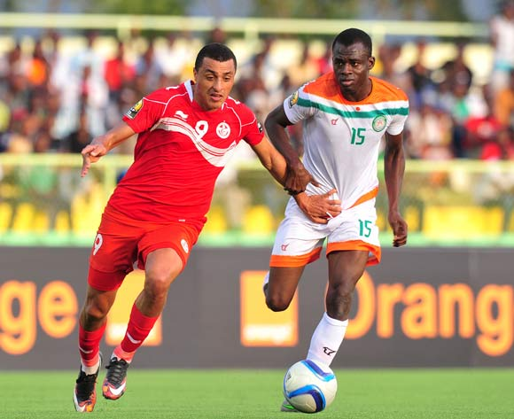 Ahmed Akaichi of Tunisia challenged by Katkore Boureima of Niger during the 2016 CHAN Rwanda, match between Niger and Tunisia at the Stade de Kigali in Kigali, Rwanda on 26 January 2016 ©Muzi Ntombela/BackpagePix
