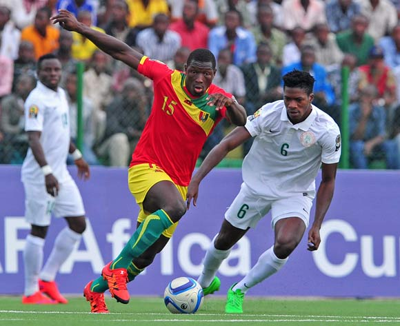 Home-based Eagles star Jamiu Alimi (right) during the 2016 CHAN Rwanda against Guinea