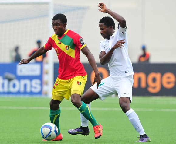 Aboubacar Sylla of Guinea controls the ball ahead of Chima Akas of Nigeria