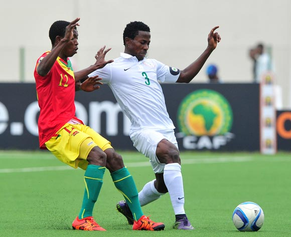 Chima Akas of Nigeria gets to the ball ahead of Aboubacar Sylla of Guinea during the 2016 CHAN Rwanda game between Guinea and Nigeria at Rubavu Stadium, Rubavu on 26 January 2016 ©Ryan Wilkisky/BackpagePix