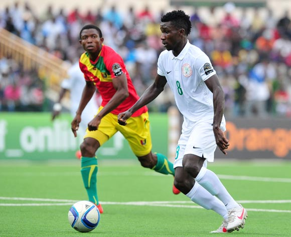 Matthew Ifeanyi of Nigeria moves forward as Aboubacar Sylla of Guinea looks on during the 2016 CHAN Rwanda game between Guinea and Nigeria at Rubavu Stadium, Rubavu on 26 January 2016 ©Ryan Wilkisky/BackpagePix